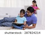 father assisting daughter while ... | Shutterstock . vector #287824214