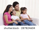 family sitting on a sofa... | Shutterstock . vector #287824604