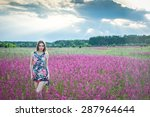 Girl Stands In A Field With...