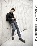 attractive man dressed in jeans ... | Shutterstock . vector #287993609