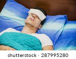 young handsome man in bed with... | Shutterstock . vector #287995280