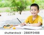 Little Asian Boy Use Pencil...
