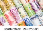 Stock photo a backgrounds with colorful of many roll currency money from many country 288290204