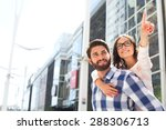 smiling woman pointing away... | Shutterstock . vector #288306713