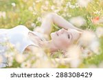 beautiful woman enjoying daisy... | Shutterstock . vector #288308429