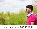 man with headphones outdoors | Shutterstock . vector #288509156