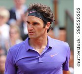 Small photo of PARIS, FRANCE- MAY 29, 2015: Seventeen times Grand Slam champion Roger Federer during third round match at Roland Garros 2015 in Paris, France
