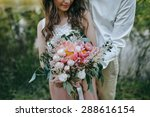 Couple Holding A Bouquet Of...