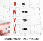 Small photo of Hand of a business man completing the puzzle with the last missing piece.Concept image of Business Acronym DWYL as Do What You Love