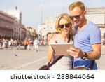 couple looking at tablet...   Shutterstock . vector #288844064