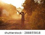 Happy Girl Running On A Dusty...