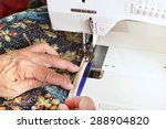 a quilter guides binding... | Shutterstock . vector #288904820