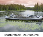Canoes Floating On A Peaceful...