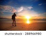 Photographer Standing On Beach  ...