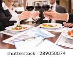 Small photo of Group of successful business people celebrating a great deal agreement.