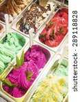 Small photo of classic mixed traditional italian gelato ice cream in shop display