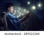 teenager boy lying in bed using ...   Shutterstock . vector #289221260