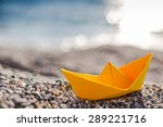 Yellow Paper Boat On Beach On...