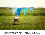 Stock photo laundry line with clothes in field 289243799
