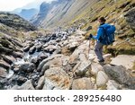 A Female Hiker Descending...
