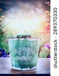 empty green bucket on wooden... | Shutterstock . vector #289370330