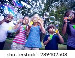 Children Playing With Bubble...