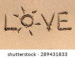 Love Word On Ocean Beach Sand