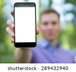 a large cell phone in hand ... | Shutterstock . vector #289432940