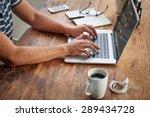 cropped shot of a man's hands... | Shutterstock . vector #289434728