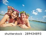 happy family in goggles looking ... | Shutterstock . vector #289434893
