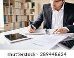 Male employee writing business...