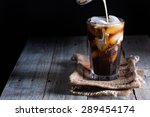 iced coffee in a tall glass... | Shutterstock . vector #289454174