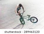 Bmx Bicycle Rider Tricking On...