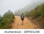 Young Male Hiker Walking Away...