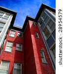 Rows of Apartment Buildings with Blue Sky in Background - stock photo