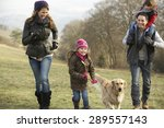 Stock photo family and dog on country walk in winter 289557143
