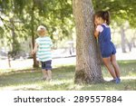 Two Children Playing Hide And...