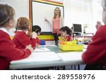 pupils sitting at table as... | Shutterstock . vector #289558976
