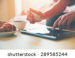 hands holding credit card and... | Shutterstock . vector #289585244