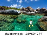 Young Woman Snorkeling In...