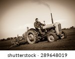 Farmer In Old Fashioned Tractor ...