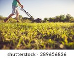 photo of a young man mowing the ... | Shutterstock . vector #289656836
