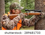 deer hunter aiming rifle in... | Shutterstock . vector #289681733