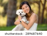 Cute Girl With White Dog...