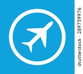 round sign with image of plane  ...