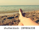female feet on blue sea... | Shutterstock . vector #289806338