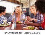 female friends eating at a... | Shutterstock . vector #289823198