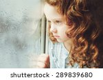 sad child looking out the... | Shutterstock . vector #289839680