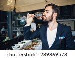 elegant young man tasting wine | Shutterstock . vector #289869578