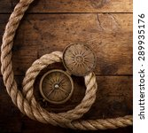 Compass And Rope On Wood....